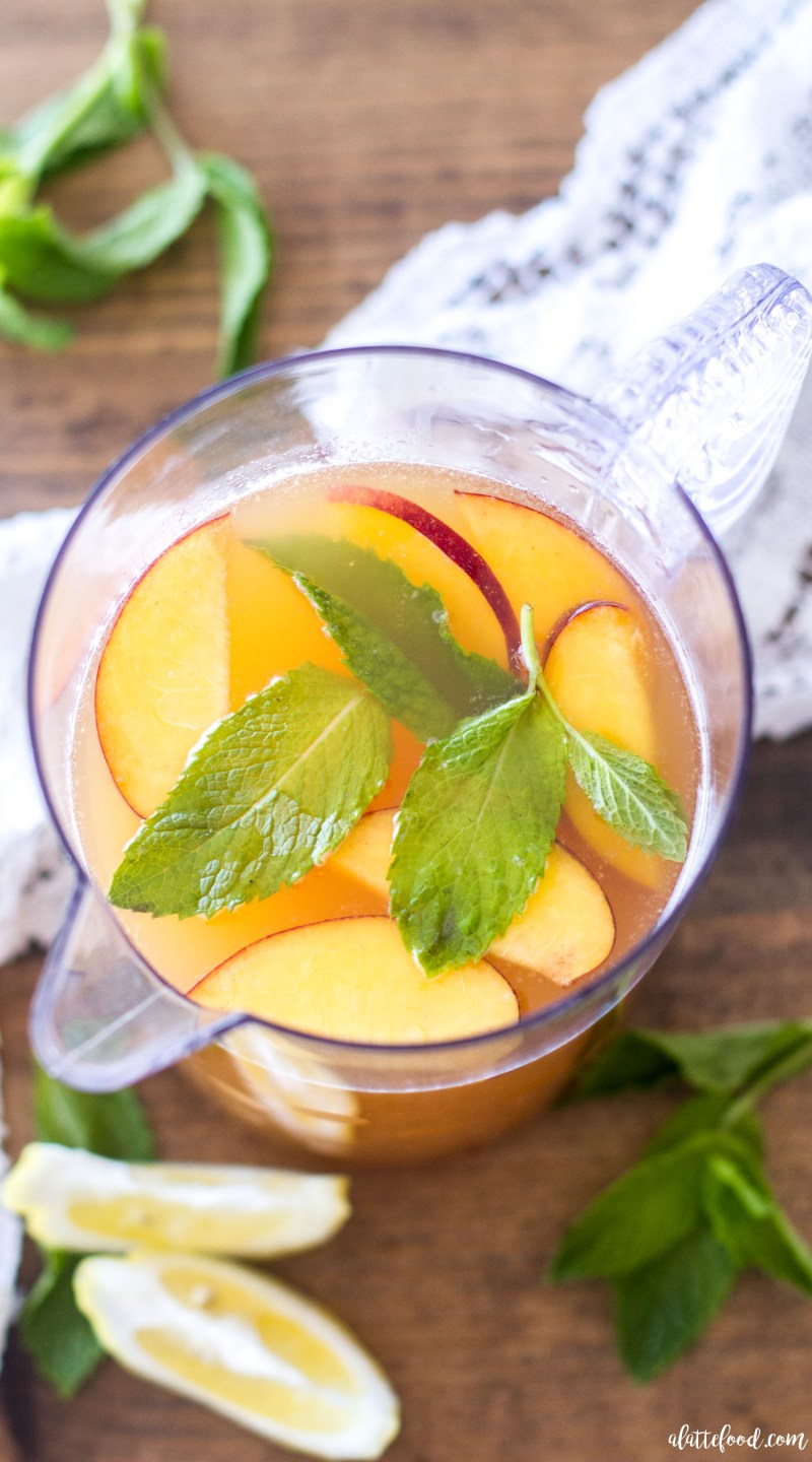 This homemade Iced Peach Green Tea is naturally sweetened, making it the perfect drink for summer! Only 4-ingredients stand between you and this pretty little homemade iced tea! homemade iced tea, peach iced tea, green tea lemonade