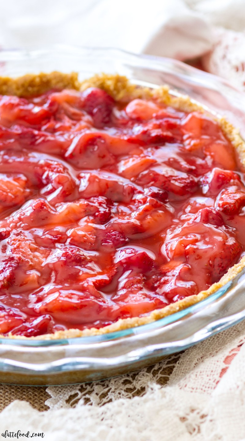 This Strawberry Lemon Pie is made with fresh strawberries, lemon curd, and a sweet graham cracker crust! This strawberry pie is super simple to make, sweet and tangy, and the perfect summer dessert! strawberry pie, no bake strawberry pie, homemade strawberry pie