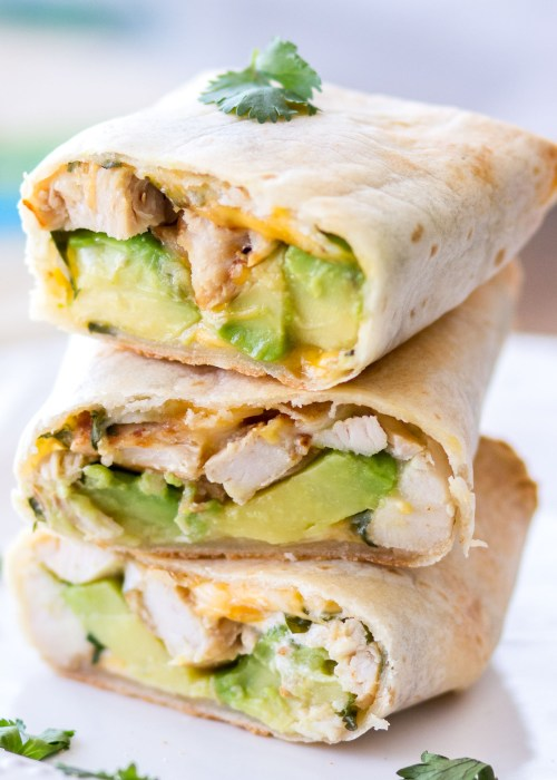 These easy Baked Avocado Chicken Burritos are made with Mission Gluten Free Tortillas, chicken, avocados, cheese, sour cream, and cilantro, then baked to perfection. The perfect weeknight dinner or quick and easy lunch!