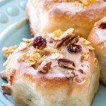 These easy Cranberry Pecan Cinnamon Rolls with a cinnamon vanilla glaze are the perfect fall breakfast! They come together quickly, making them a 1-hour cinnamon roll recipe, and are full of sweet fall flavors, like cranberries, pecans, and cinnamon!