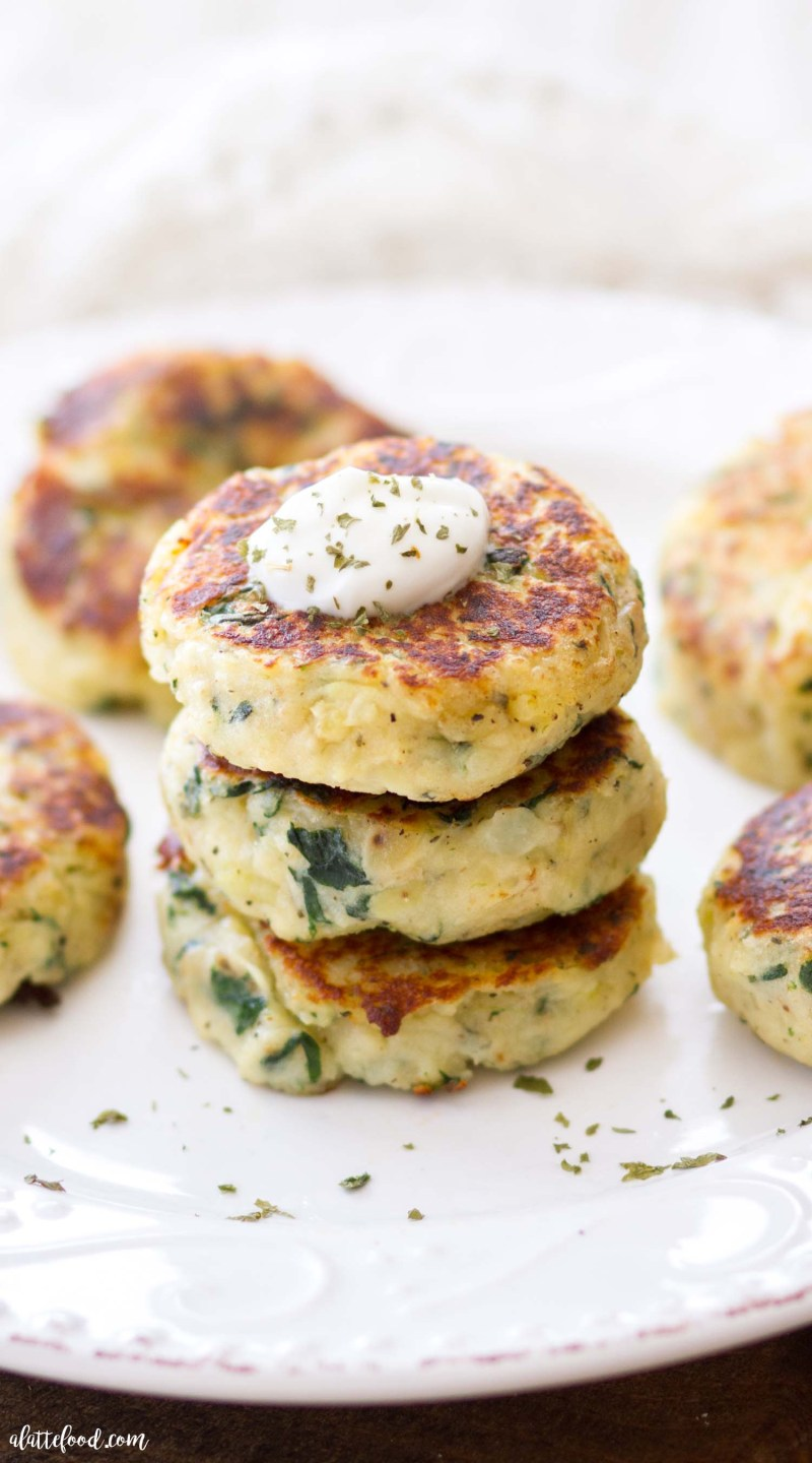spinach and herb potato cake recipe stacked on plate