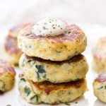 These easy Mini Spinach and Herb Potato Cakes are so flavorful! They are an easy side dish recipe perfect for a holiday dinner or quick and easy weeknight meal! Yellow potatoes are boiled, mashed, and then mixed with a combination of cooked spinach, herbs, and cheese, and fried to perfection.