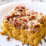 This easy pumpkin coffee cake recipe is full of sweet spices, rich pumpkin flavor, and topped with a pecan brown sugar crumb topping! This sweet fall breakfast treat is perfect when paired with a cup of coffee!