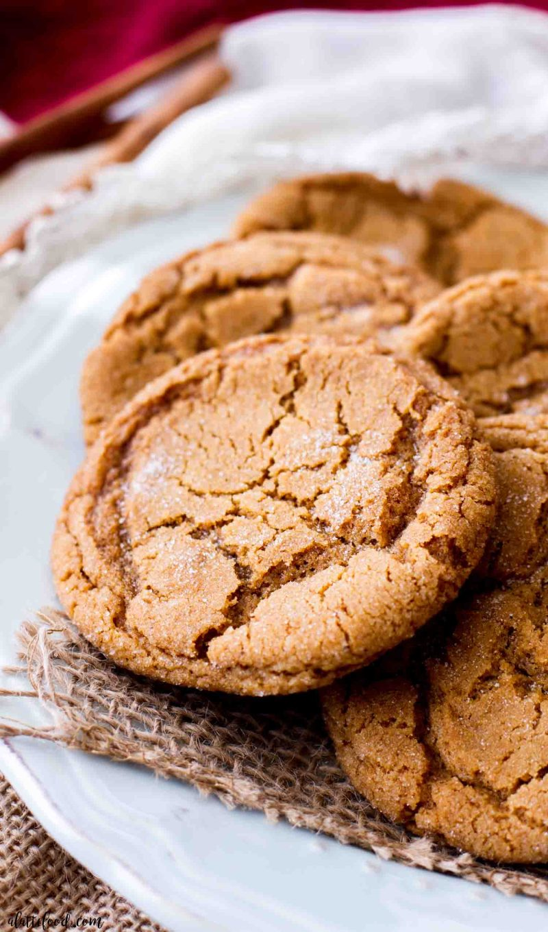 homemade molasses cookies with sugar on a plate