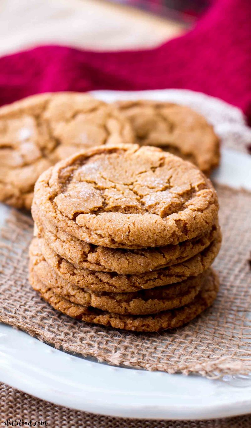 molasses cookies stacked on a blue plate