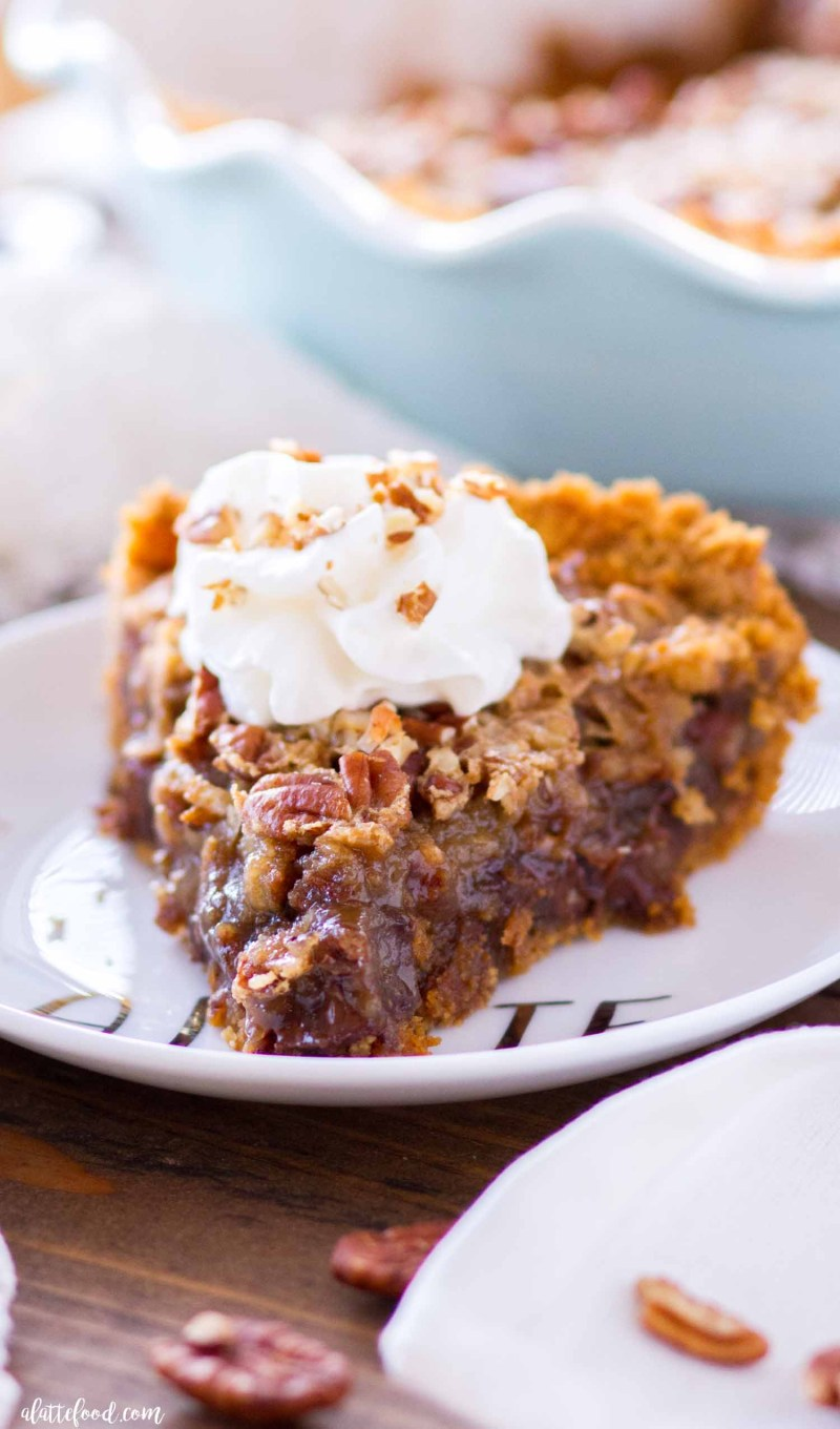 This German Chocolate Pecan Pie combines the classic pecan pie recipe (made without corn syrup) with the amazing flavors of German chocolate! This German Chocolate Pecan Pie is made in a homemade graham cracker crust, and is rich, sweet, and the perfect Thanksgiving dessert (or Christmas dessert) addition!