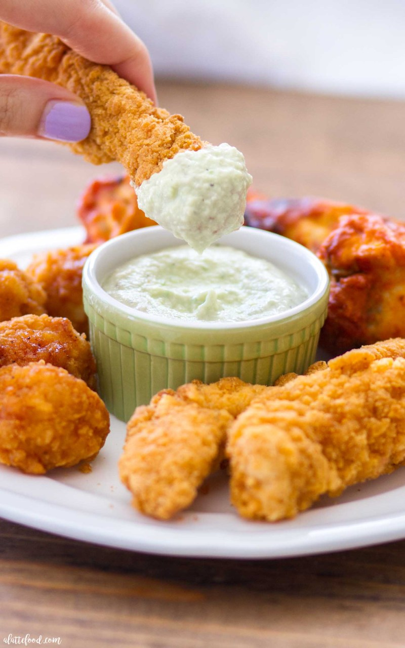 This homemade avocado ranch dipping sauce is the perfect dip for any game day! It pairs perfectly with wings, chicken strips, crackers, and even chips! These easy game day snacks with avocado ranch dipping sauce are perfect for your next party!