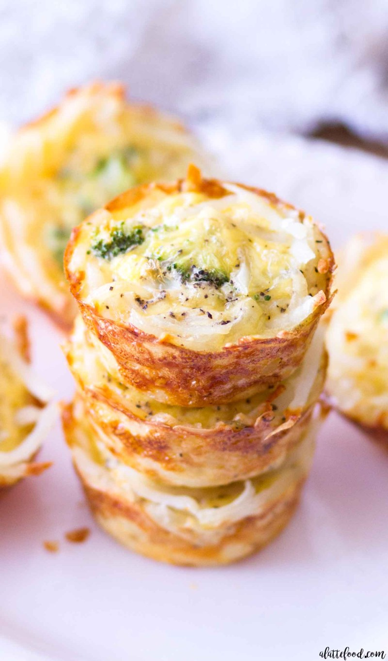 This homemade quiche recipe is for Hash Brown Crusted Broccoli and Cheddar Quiche Cups. These mini broccoli and cheddar quiche cups use hash browns for the crust instead of pastry dough, which is a fun and unique twist on the classic quiche recipe! Plus, the hash browns are golden brown, crispy, and make these mini quiche cups naturally gluten free!
