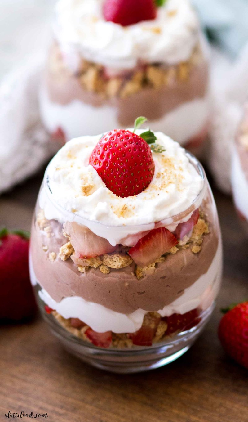 best chocolate cheesecake strawberry trifles (no bake) on wooden board