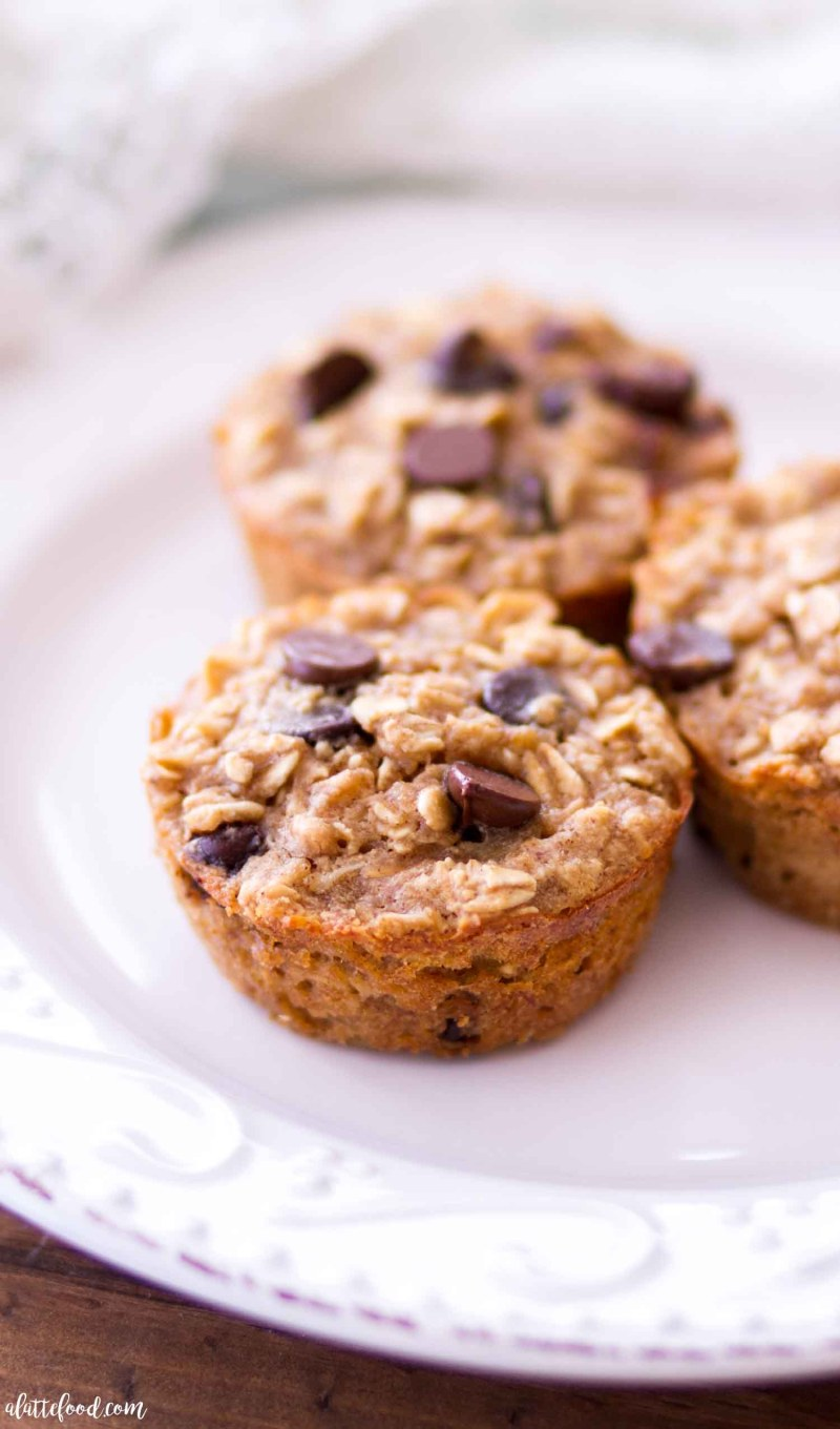 three baked peanut butter banana oatmeal cups on white plate