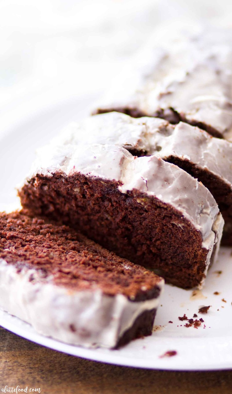 This Chocolate Banana Bread recipe is rich, delicious, and absolutely perfect with the homemade coffee glaze. This homemade banana bread recipe has a chocolatey twist that makes it entirely irresistible! Chocolate Banana Bread makes the perfect addition to breakfast or brunch!