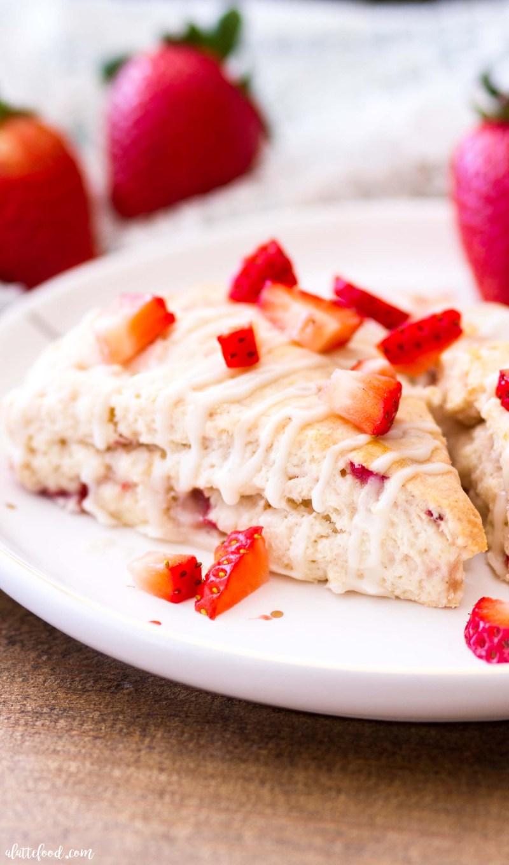 strawberry cream cheese scone on white polka dot plate