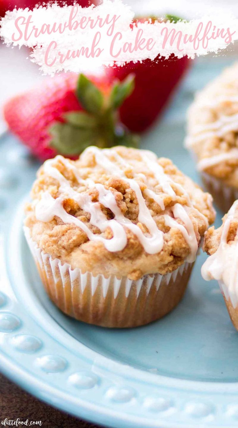 glazed strawberry crumb cake muffins on teal plate