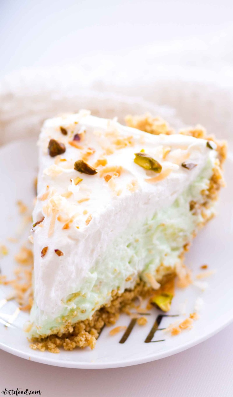 This homemade no bake pistachio pudding cream pie is layers of graham cracker crust, pistachio pudding cream, and whipped cream! Plus, this pistachio cream pie is filled with sweet pineapple and coconut! This easy no bake dessert would make the perfect Easter dessert, or with it's pretty color, even a St. Patrick's Day dessert!