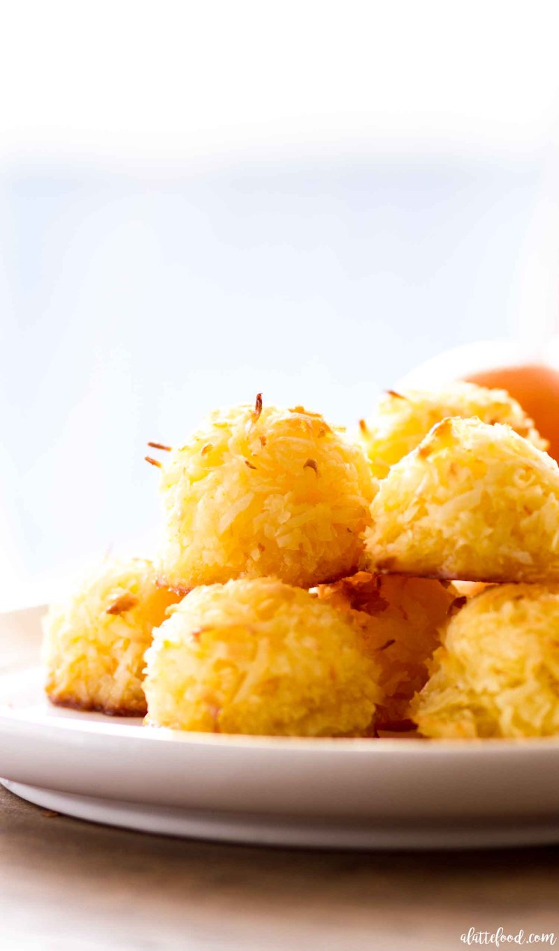 These homemade Orange Coconut Macaroons are sweet, simple, and such a perfect spring or summer dessert! This Orange Coconut Macaroon recipe is made with only a few ingredients, including fresh orange zest and orange juice! Whole eggs and a little bit of butter make these chewy coconut macaroons extra rich. Plus, these easy coconut macaroons are naturally gluten free!