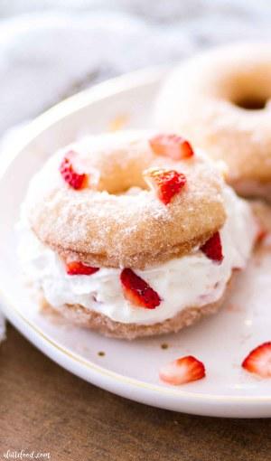 cinnamon sugar shortcake donuts with fresh strawberries and whipped cream