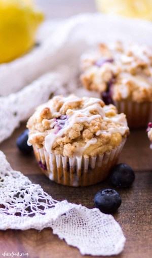 crumb cake topped lemon blueberry muffin with glaze