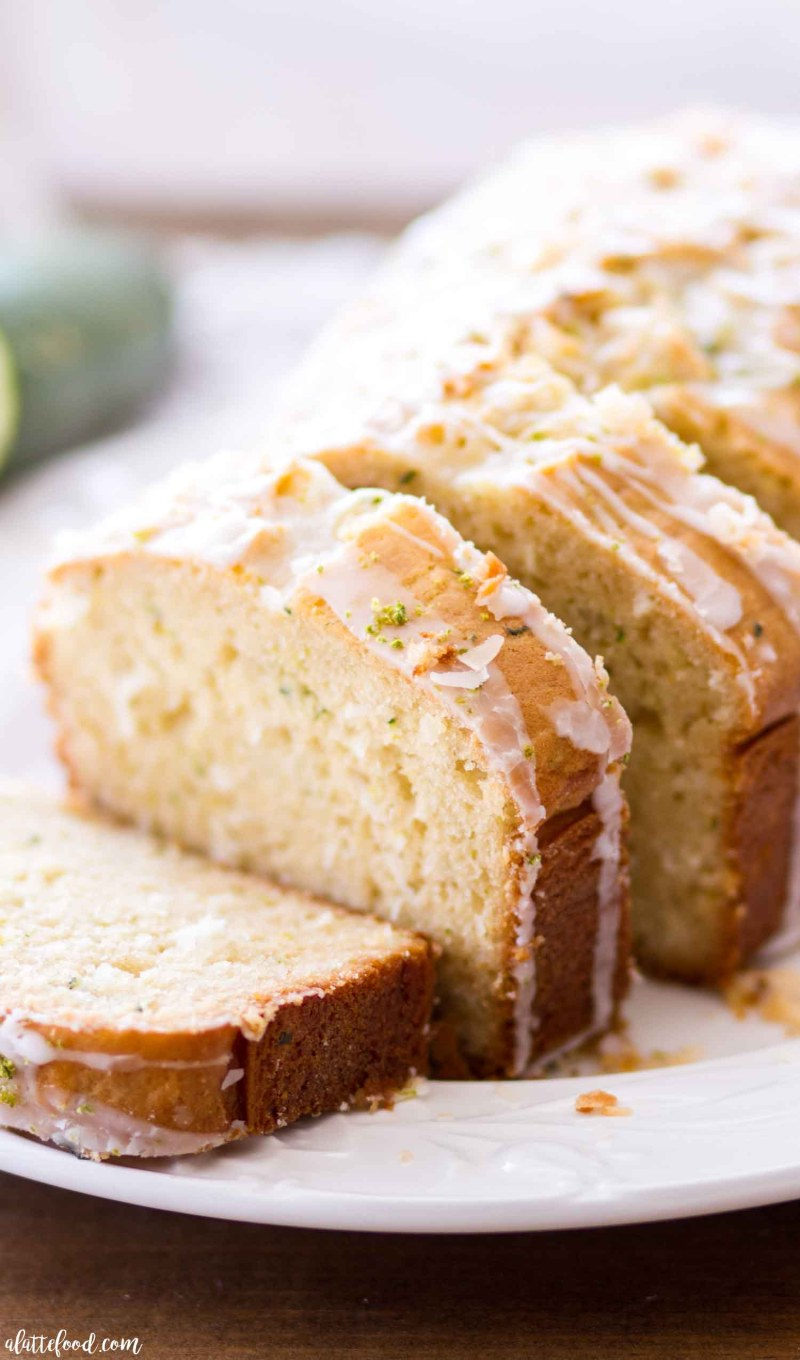 This simple Lime Coconut Zucchini Bread gives the classic zucchini bread recipe a tropical twist! This homemade zucchini bread recipe begins with my mom's zucchini bread recipe, but is flavored with a bit of lime, sweet coconut, and topped with a fresh lime glaze and toasted coconut! My favorite easy quick bread recipe! lime coconut zucchini bread, how to make zucchini bread, easy zucchini bread recipe