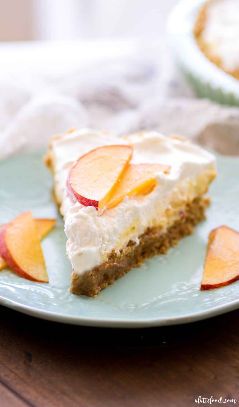 slice of no bake peach pie with cream and fresh peaches