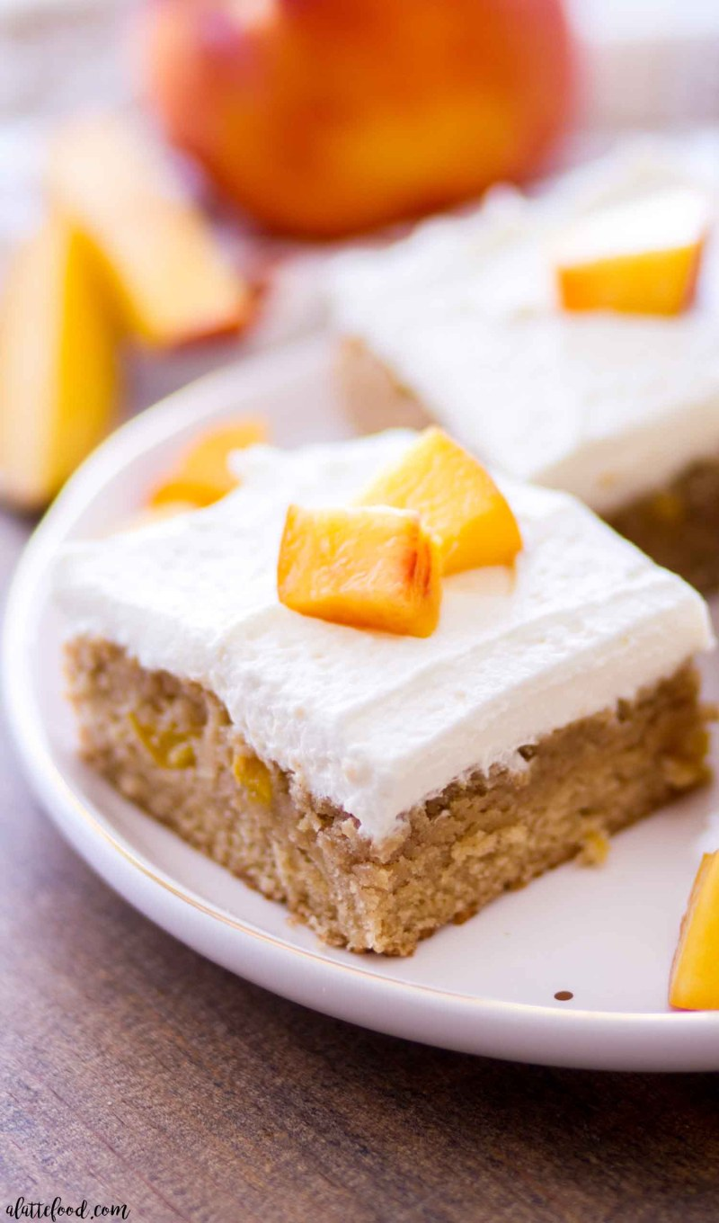 peach pie blondies with whipped cream on white plate