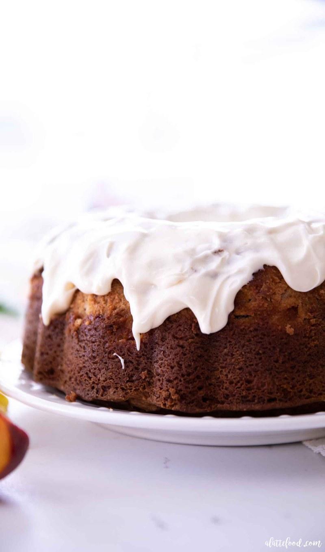 cream cheese glazed peach bundt cake on white plate
