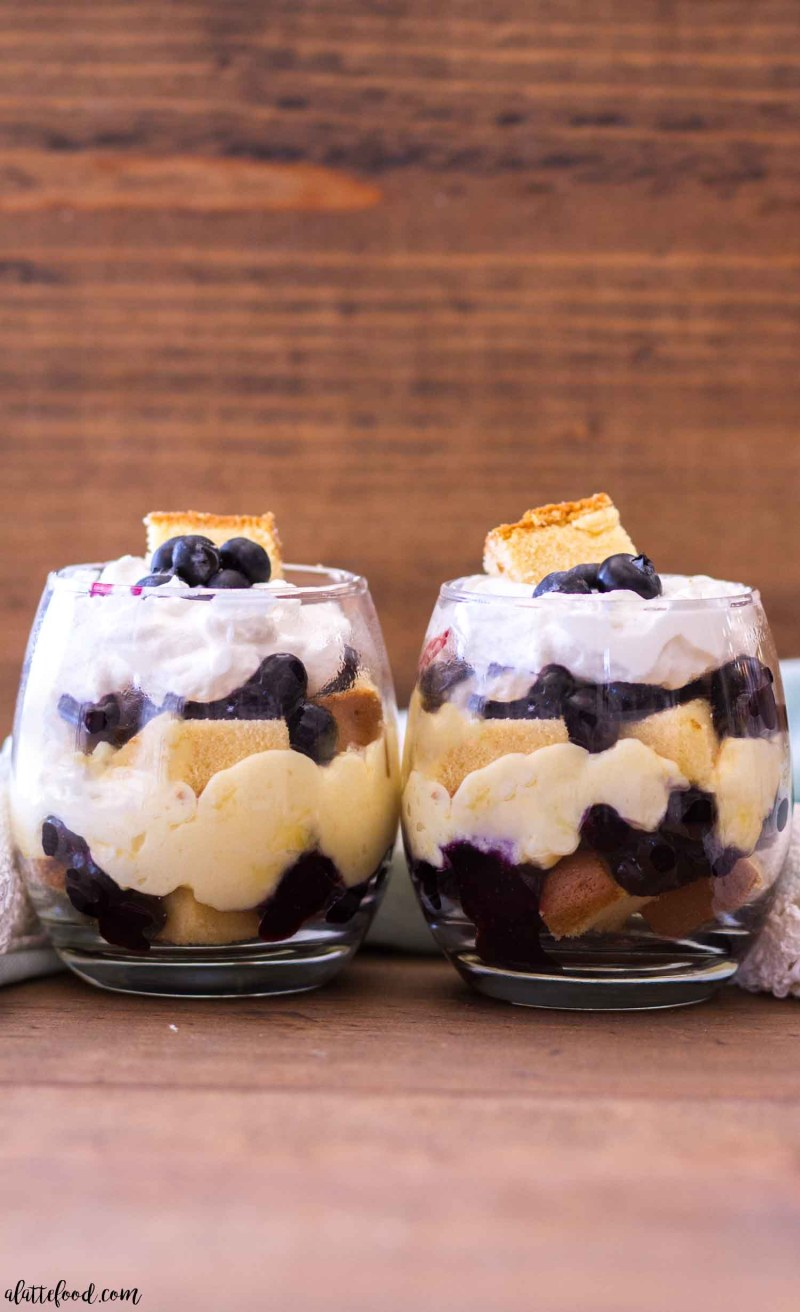 These no bake blueberry lemon pound cake trifles are filled with blueberry pie filling and easy lemon pudding. Whether you use homemade pound cake or store-bought pound cake, this easy blueberry lemon trifle recipe is sure to be a hit! #lemon #dessert #recipe #easy