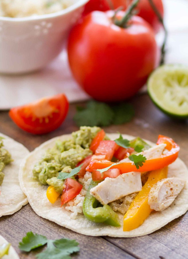 Easy Sheet Pan Chicken Fajitas -- side view chicken fajitas on corn tortillas