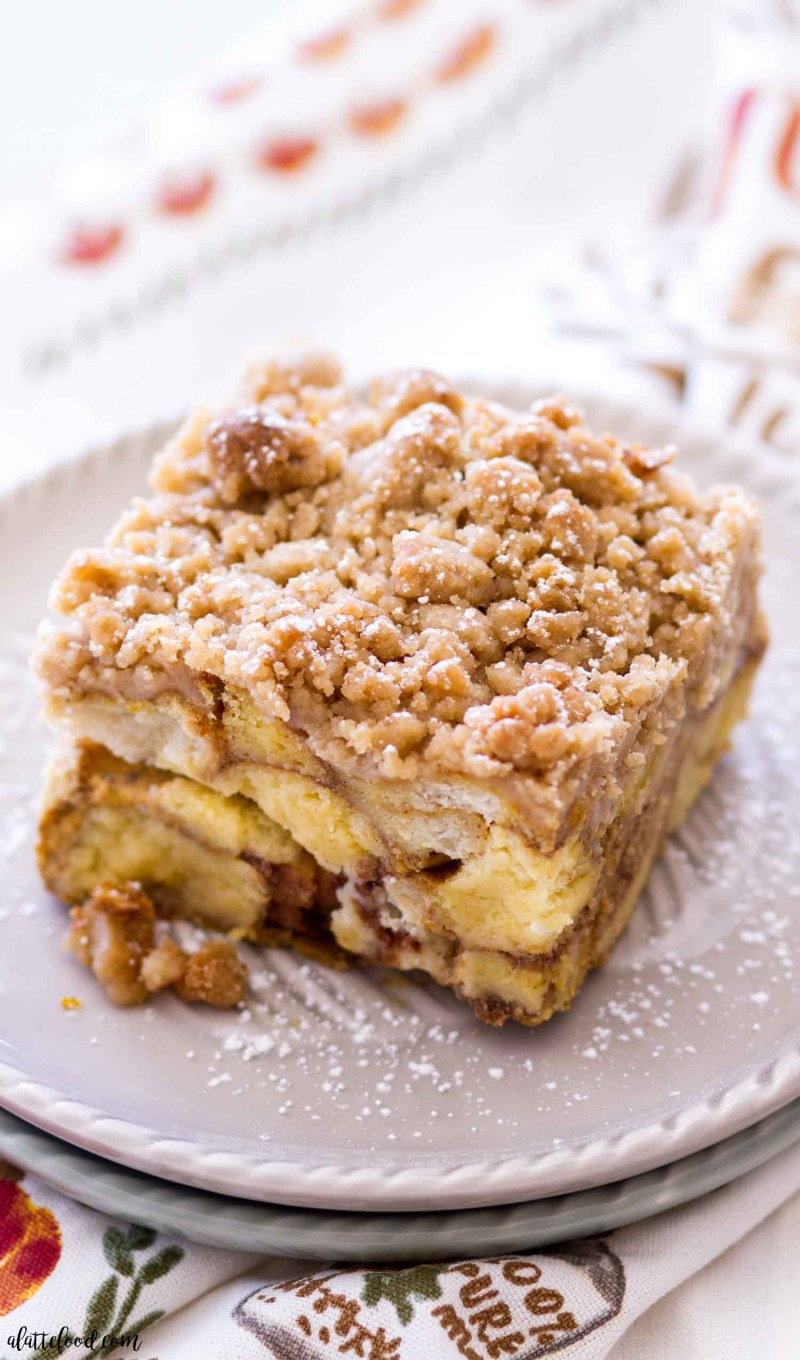 slice of pumpkin donut french toast casserole with a brown sugar topping
