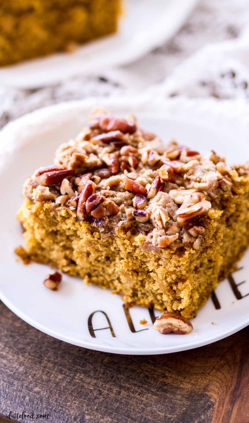 pumpkin coffee cake with toasted pecans on white dessert plate