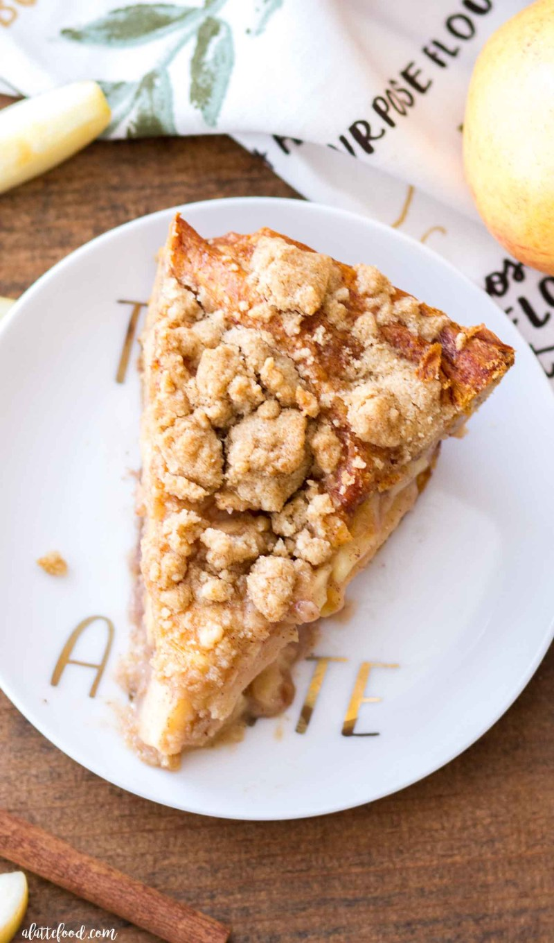 This homemade Cinnamon Roll Dutch Apple Pie uses a cinnamon roll crust instead of a pastry crust. The cinnamon rolls give this Dutch Apple Pie recipe a flaky, buttery crust and the dutch apple topping pairs perfectly with the cinnamon roll filling in the crust. Plus a step-by-step video!