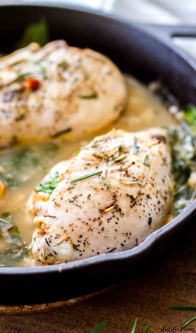 Sun Dried Tomato Stuffed Tuscan Chicken Breasts in a light spinach cream sauce.