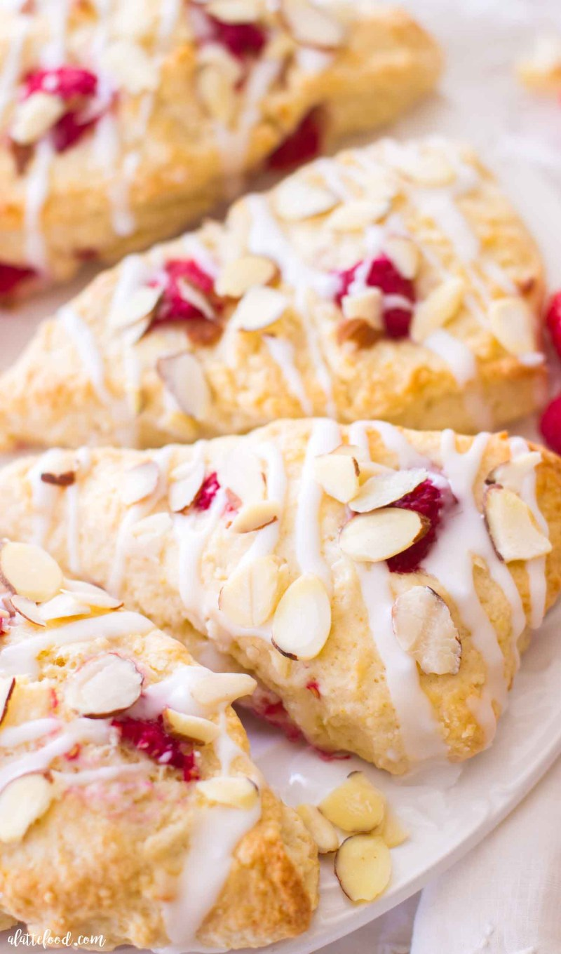 raspberry cream scones on white plate