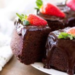 chocolate pound cake slice with strawberries and ganache