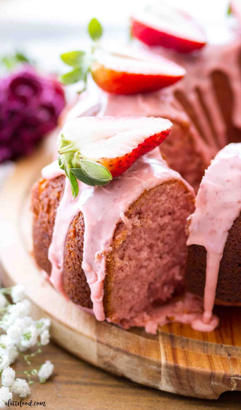 A slice of homemade strawberry bundt cake made from scratch with fresh strawberries.