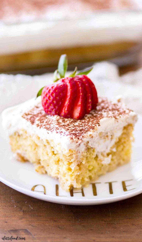A slice of this easy tiramisu poke cake is a fun twist on a classic coffee recipe!