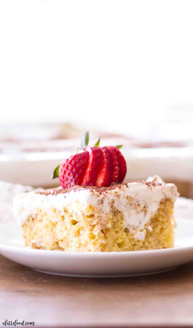 The best dessert is a slice of this tiramisu poke cake that's soaked with a coffee cream and topped with whipped cream.