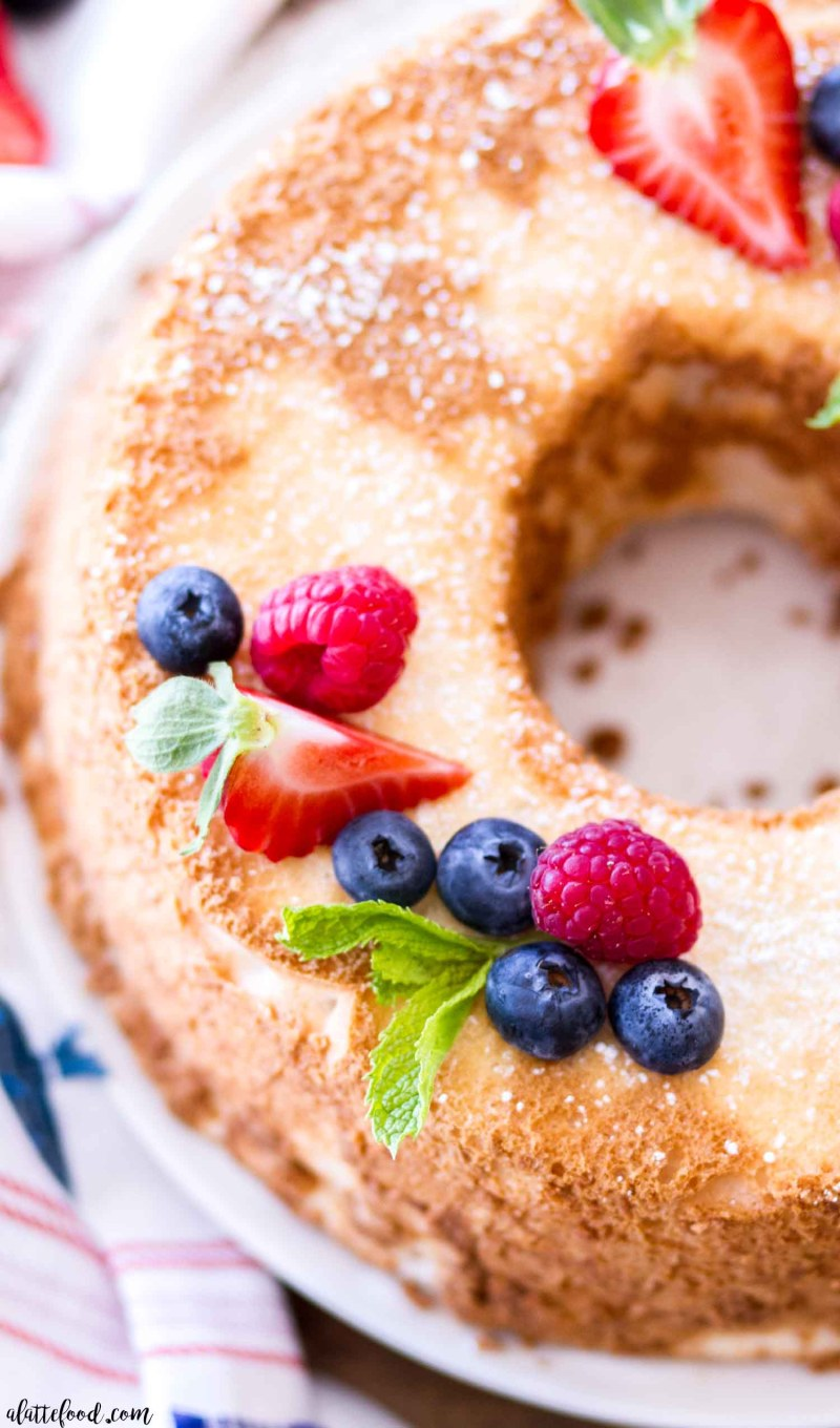 baked angel food cake topped with fresh berries