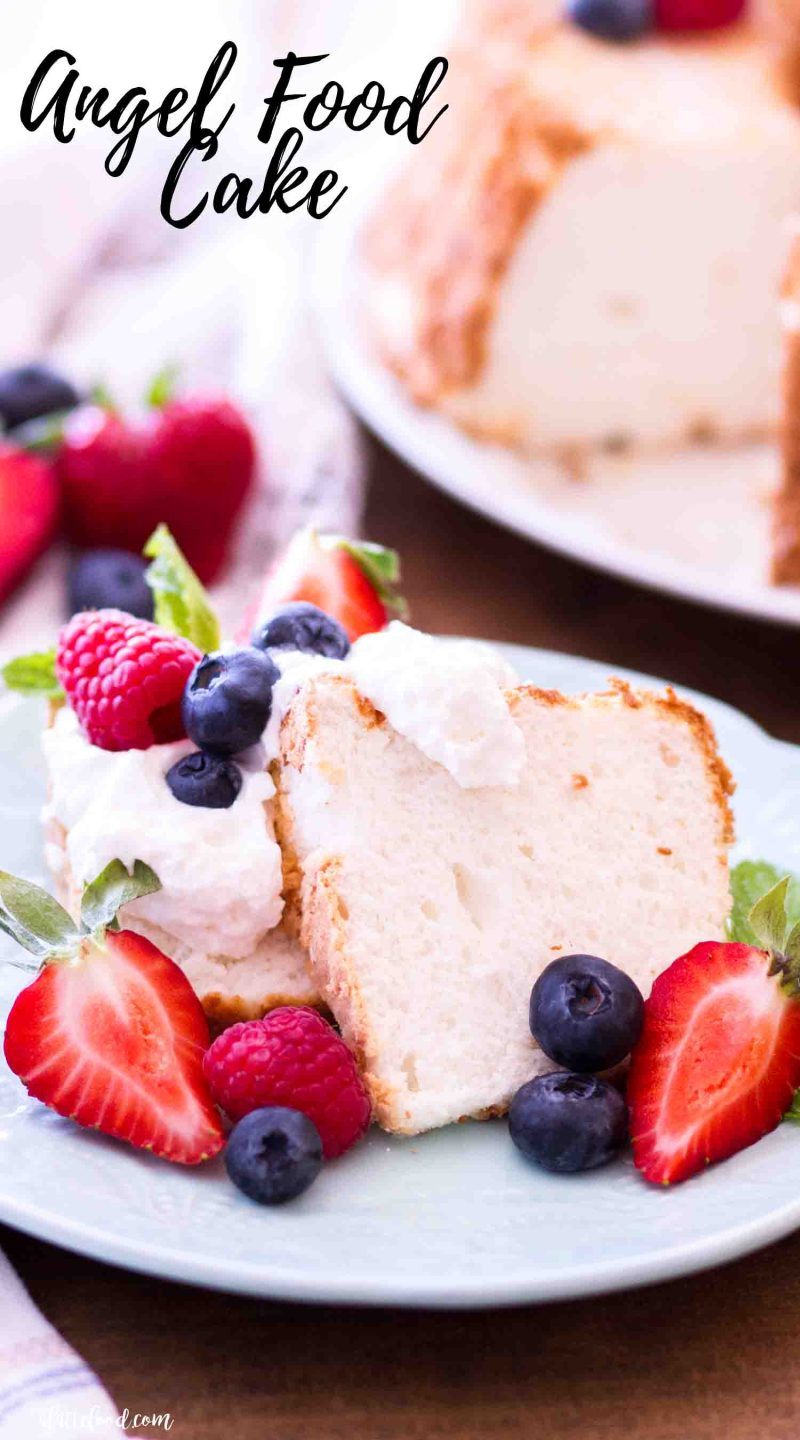 The best angel food cake recipe is topped with fresh berries and homemade whipped cream