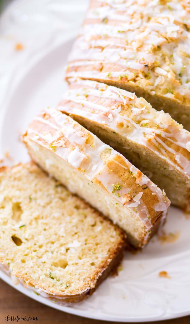 slices of lime coconut zucchini bread on white plate