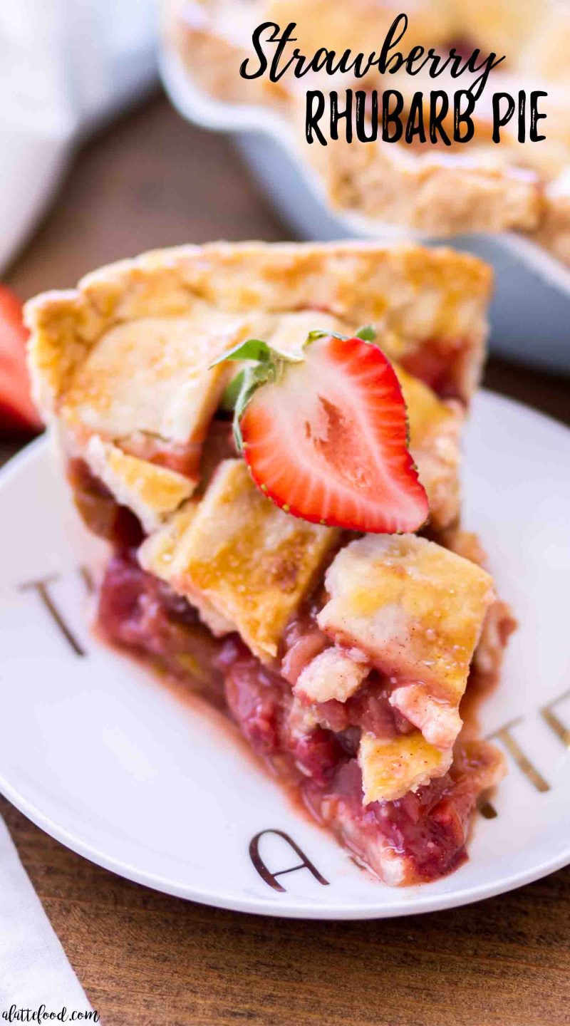Homemade Strawberry Rhubarb Pie slice (on a white plate) with a butter lattice pie crust