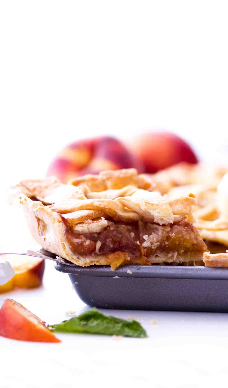 Easy Peach Slab Pie with fresh peaches is perfect when made with an all butter pie crust.