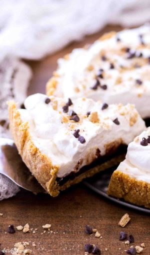 Slice of this easy s'mores tart recipe on a pie server