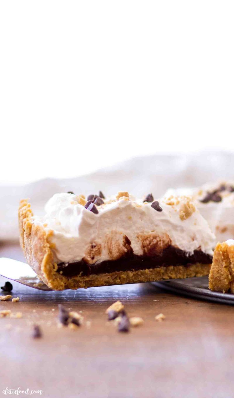 Slice of easy no bake chocolate s'mores tart with layers of ganache and marshmallow cream