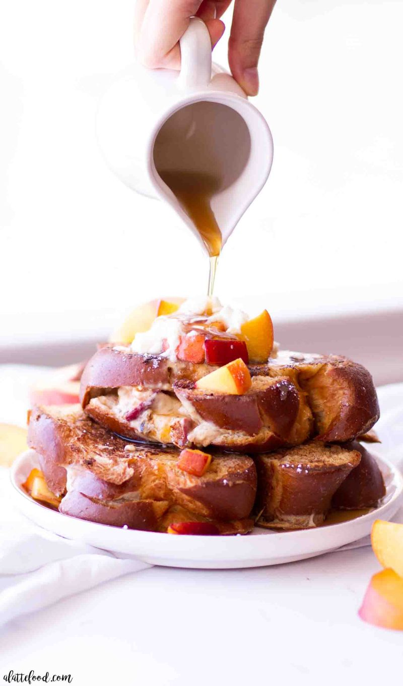 Easy peach cheesecake french toast topped with maple syrup