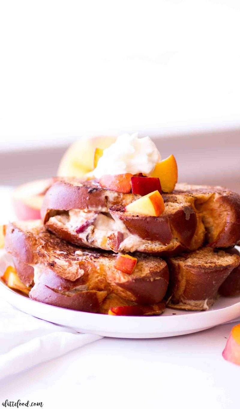 Homemade cheesecake stuffed french toast with peach pie filling