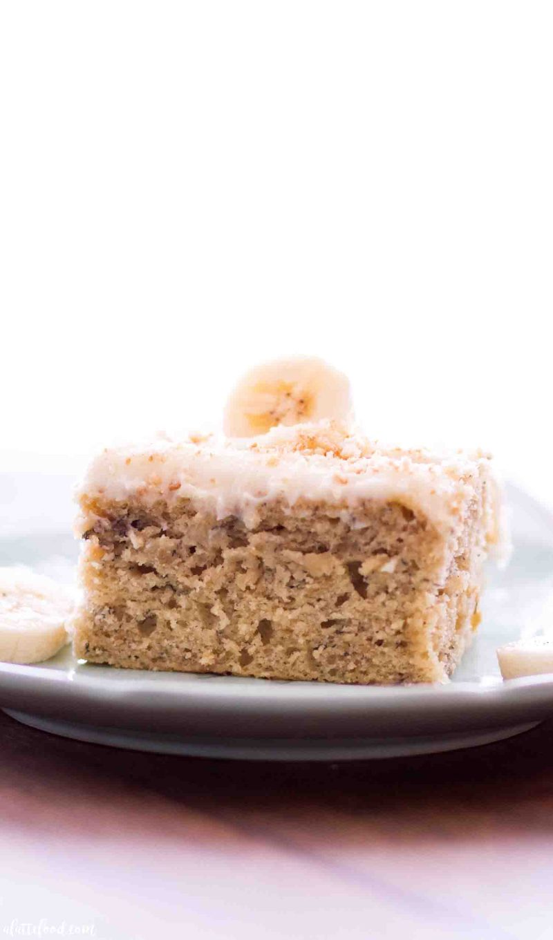 Slice of cream cheese frosted banana sheet cake