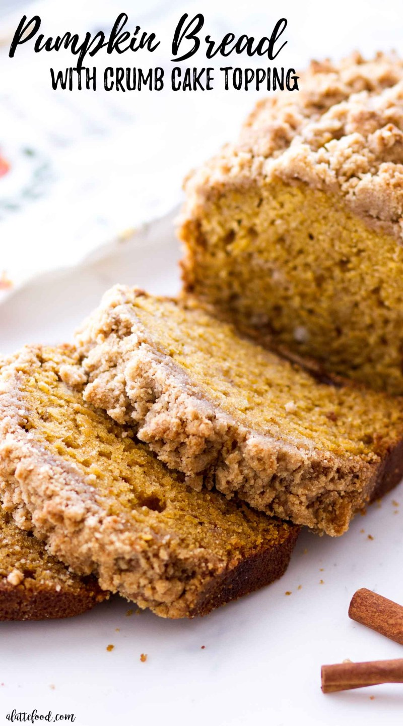 Easy Pumpkin Bread with strusel sliced on a white cutting board (with text)