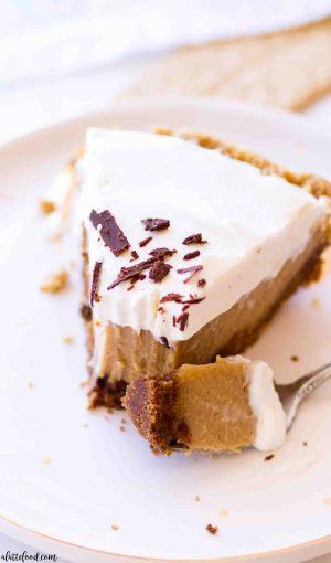 Creamy Peanut Butter Pie slice with peanut butter custard on a white plate