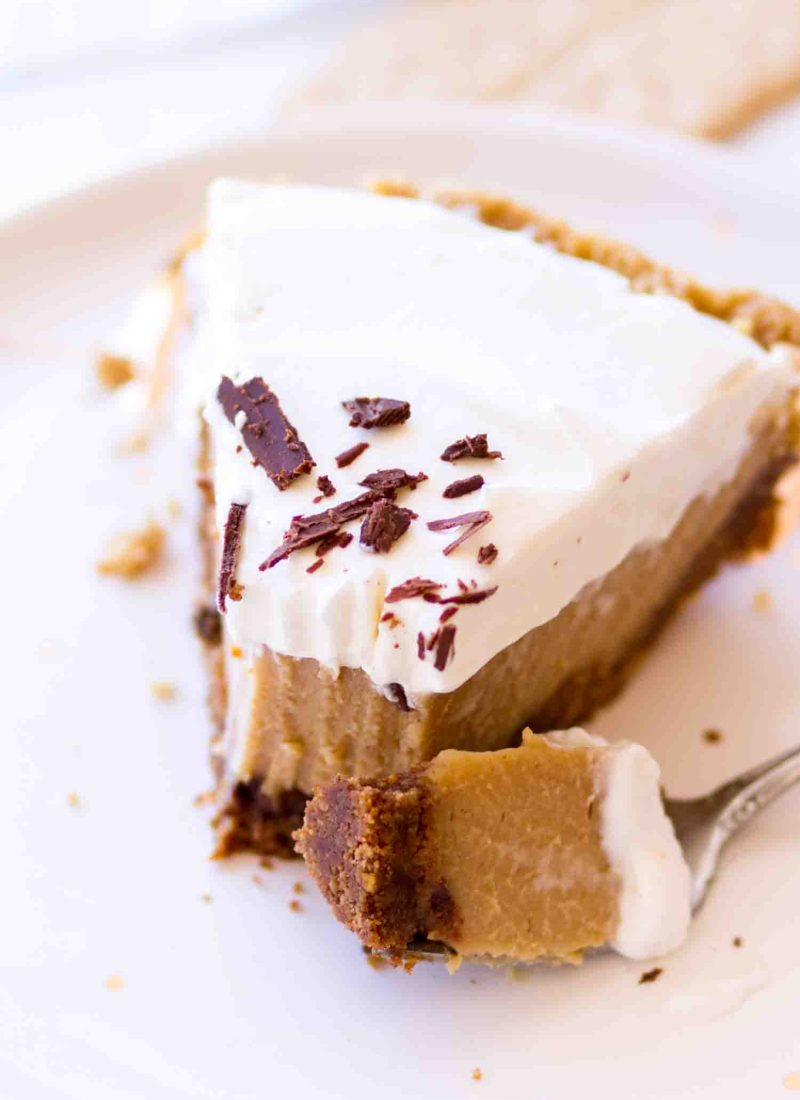 Creamy Peanut Butter Pie slice with peanut butter custard on a white plate