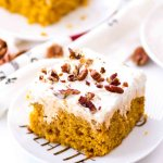 slice of pumpkin poke cake with pumpkin filling
